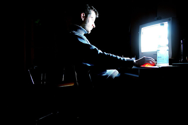 man-using-computer-at-night